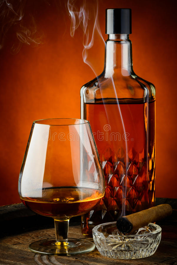 Brandy and cigar stock photography