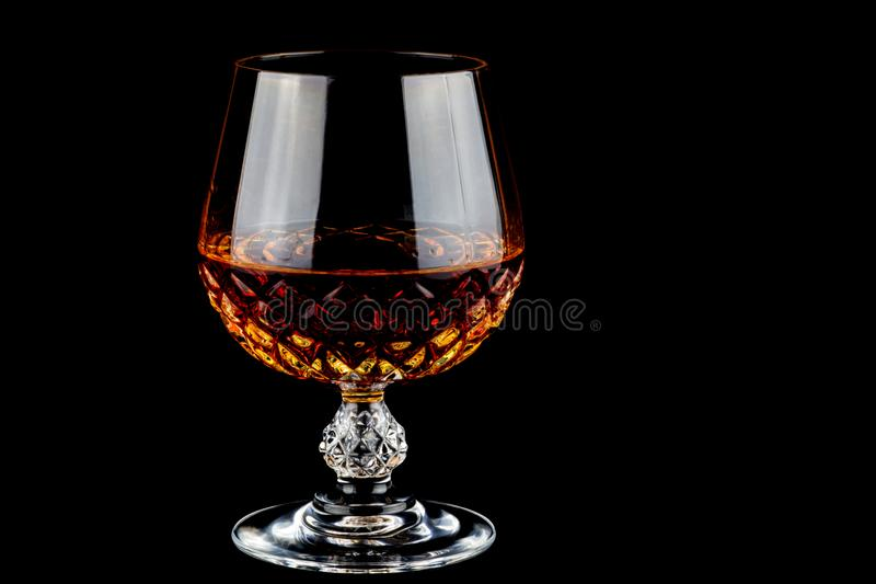 Brandy in a Crystal Glass on a Black Background stock photo
