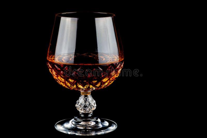 Brandy in Crystal Glass su un fondo nero fotografia stock