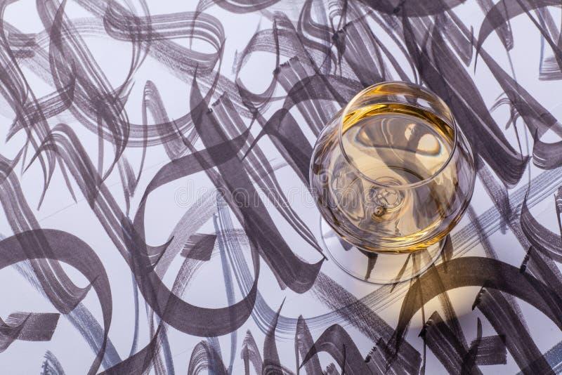 Brandy i kaligrafia fotografia stock