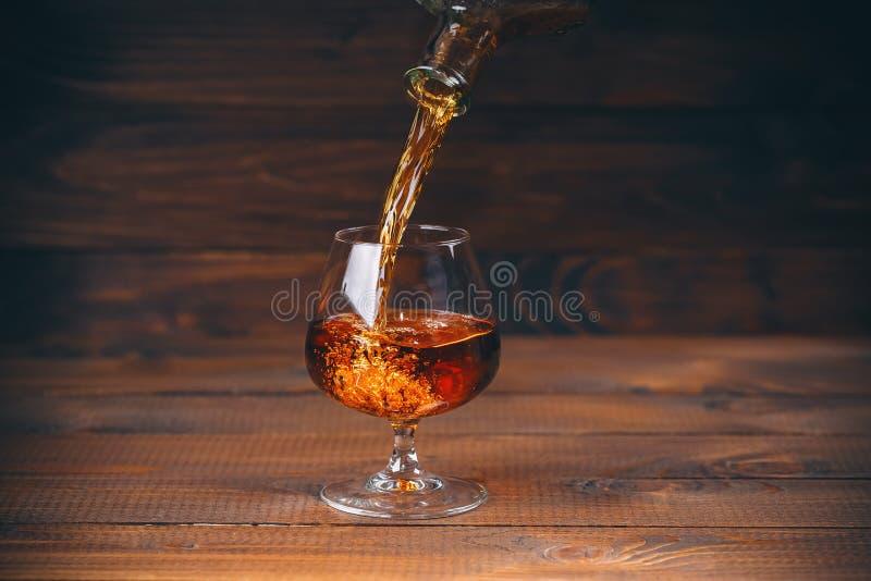 Brandy o cognac nel vetro fotografie stock libere da diritti