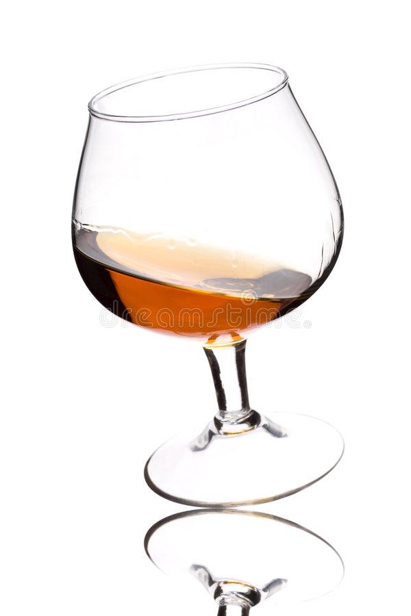 Brandy on white. Glass of brandy on white royalty free stock photography