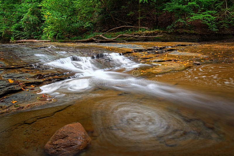 Brandywine Creek Falls. A small waterfall on Brandywine Creek in Cuyahoga Valley National Park Ohio. Seen here in summer with low water flow stock photography