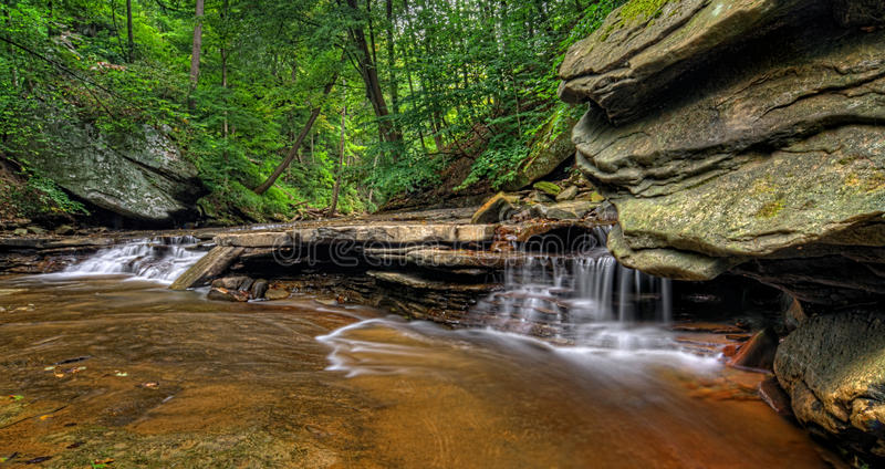 Brandywine Creek Falls. A small waterfall on Brandywine Creek in Cuyahoga Valley National Park Ohio. Seen here in summer with low water flow royalty free stock photography