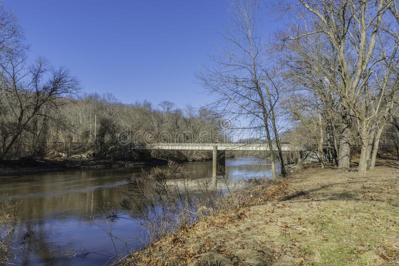 Brandywine Creek in Wilmington, Delaware. With a bright blue sky and reflections in the water looking toward Thompsons Bridge stock images