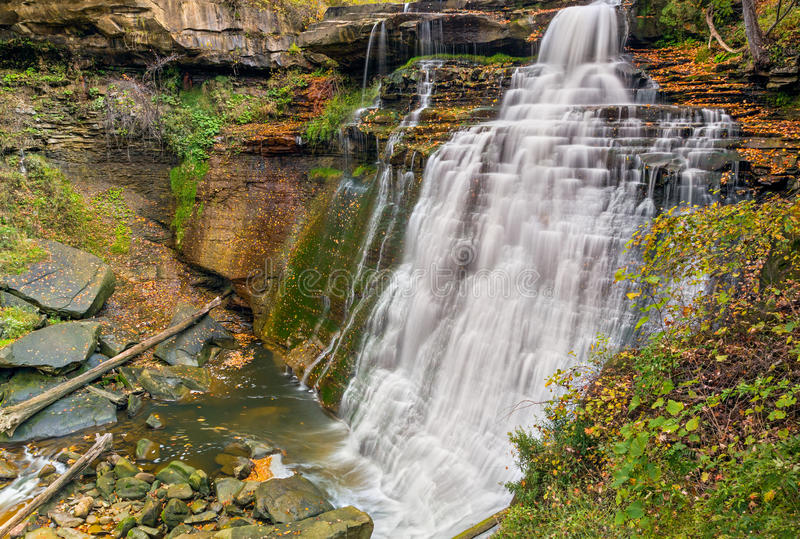 Brandywine Falls. A beautiful large waterfall in Ohio's Cuyahoga Valley National Park, cascades over rock ledges with colorful autumn leaves all around stock photo