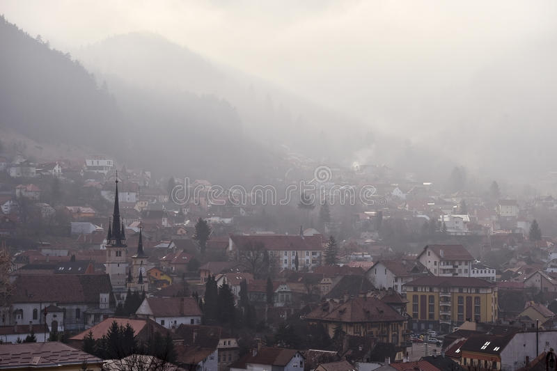 Braov old town Schei in winter season at dawn. Winter scene at dawn with Schei district, the old town of Brasov city in Romania stock images