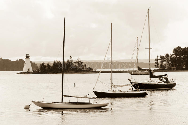 Bras D'Or Lake. Boats and lighthouse on Bras D'Or lake, Cape Breton, Nova Scotia royalty free stock image