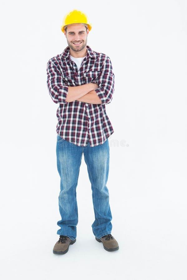 Bras debout de bricoleur masculin de Handome croisés photo libre de droits