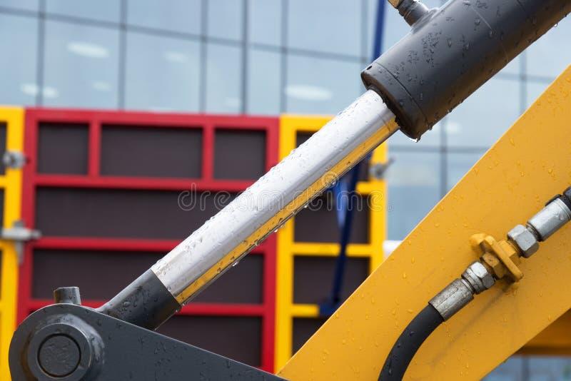 Bras hydraulique d'excavatrice de piston de bouteur photo stock