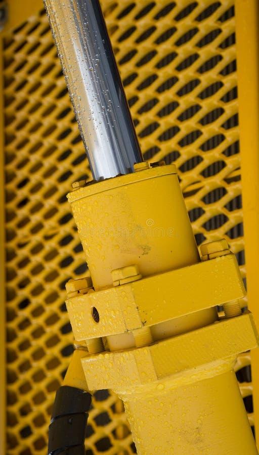 Bras hydraulique d'excavatrice de piston de bouteur photographie stock