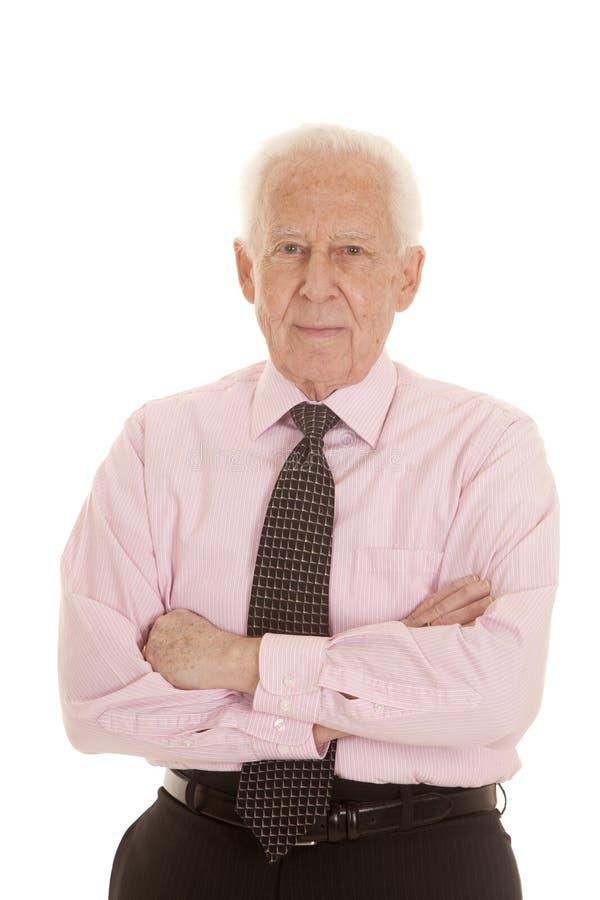 Bras pluss âgé de chemise de rose d'homme pliés photo stock
