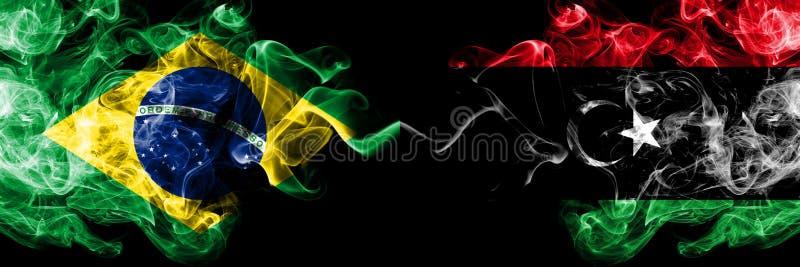 Brasil contra Líbia, bandeiras líbios do fumo colocadas de lado a lado Bandeiras de seda coloridas grossas do fumo do brasileiro  imagem de stock