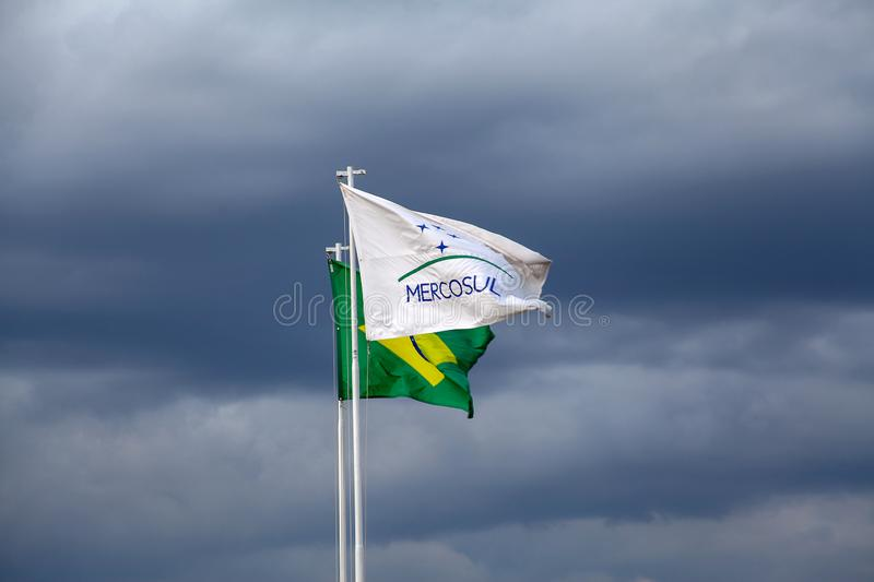 Flags of Brazil and Mercosur. Brasilia, Brazil, September 3, 2019: Flags of Brazil and Mercosur common market between Argentina, Uruguay, Paraguay, Brazil and royalty free stock image