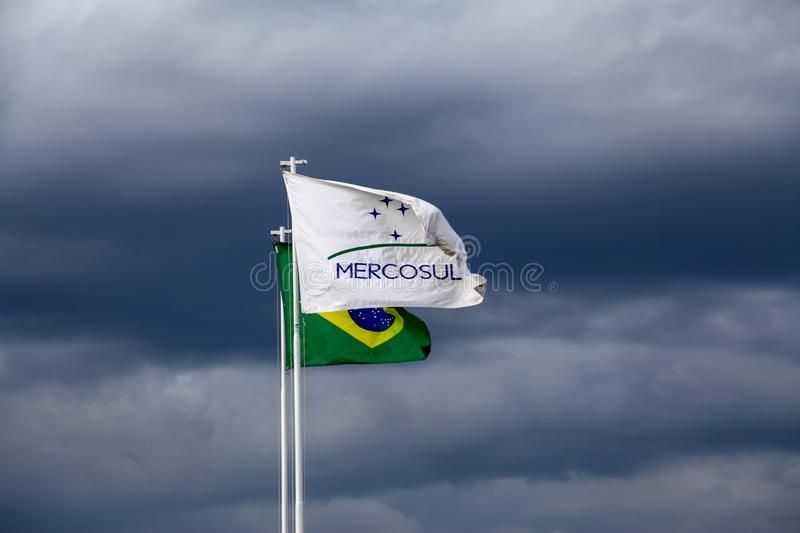 Flags of Brazil and Mercosur. Brasilia, Brazil, September 3, 2019: Flags of Brazil and Mercosur common market between Argentina, Uruguay, Paraguay, Brazil and royalty free stock photo