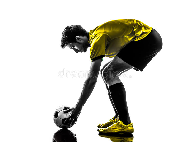 Brasilianisches Schattenbild des jungen Mannes des Fußballfußballspielers stockfoto