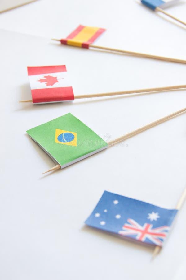Brasilianpappersflagga bland andra landsflaggor på vit bakgrund royaltyfria foton