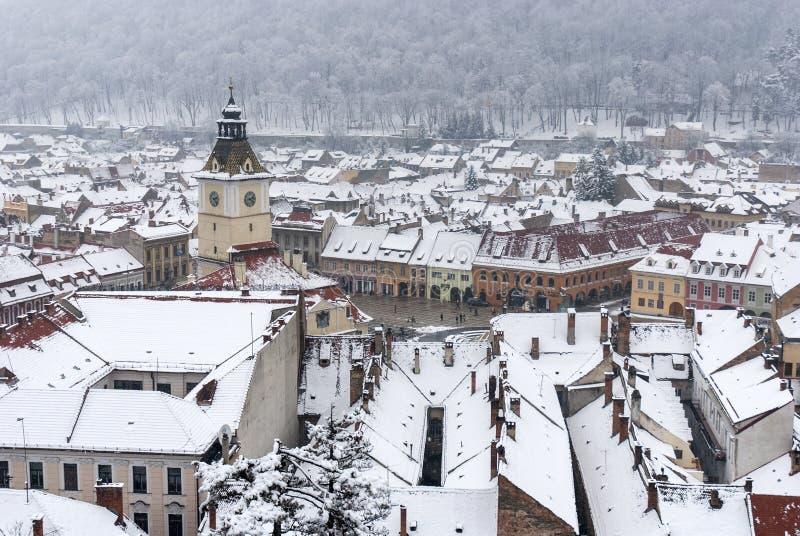 Brasov central square in winter time. Brasov central square `Piata Sfatului` in winter time, Transylvania, Romania stock photos