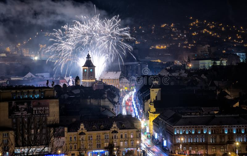 Brasov cityscape by night on new years eve with fireworks. Transylvania Romania royalty free stock photography