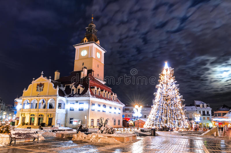 Brasov, Council Square, Christmas in Romania. Brasov, Romania. Council Square and Xmas Tre. Historical medieval old city center square of Brasov in Christmas stock image