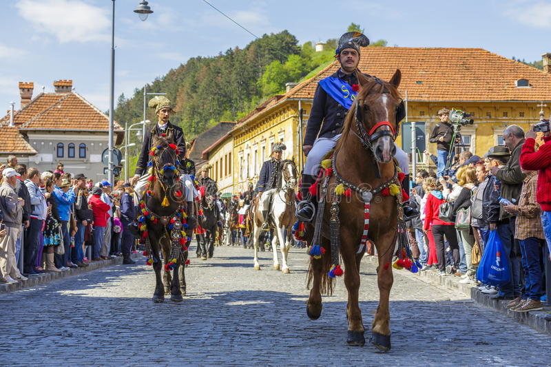 Brasov Juni parade, Brasov, Romania. Unidentified riders of Dorobanti Junii horsemen group in festive costumes participate at the traditional parade of the stock photos