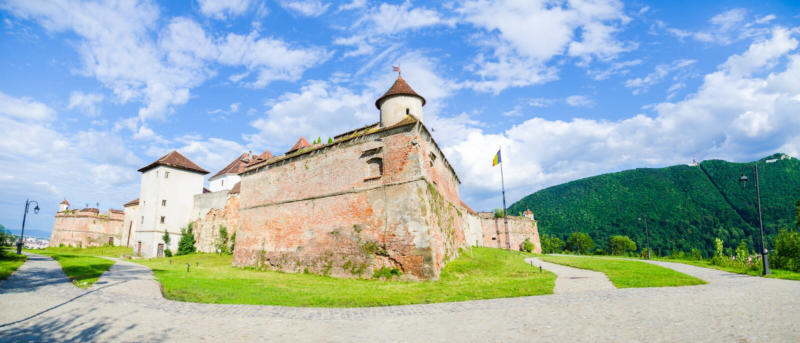 Brasov medieval fortress in Transylvania region of Romania. Brasov Guard Fortress on the hill above wich is a medieval fortification now a tourist attraction in royalty free stock photo