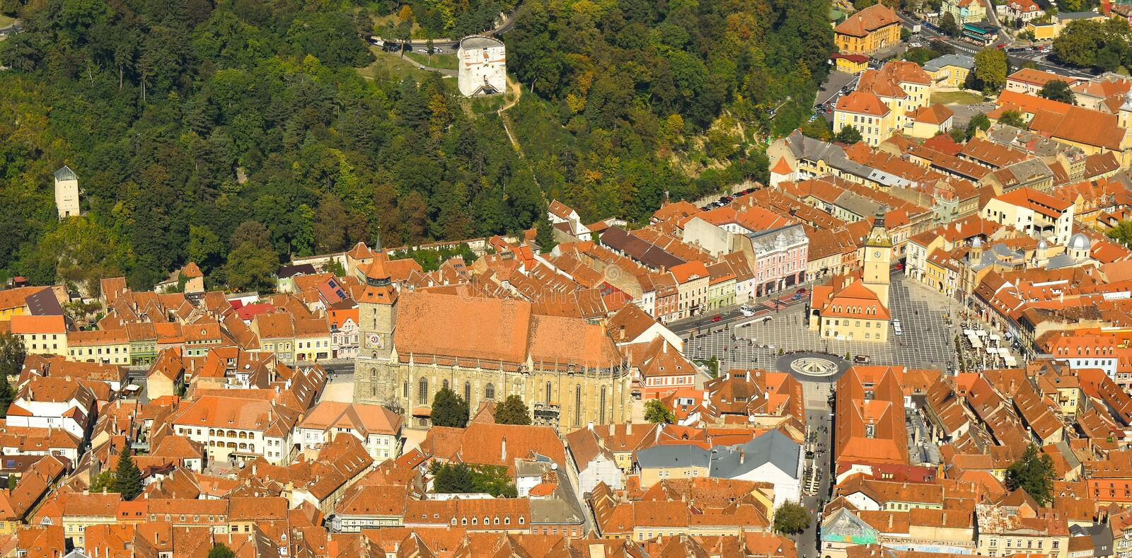 Brasov Old City Hall. Council Square. Autumn view from above Tampa Mountain. Brasov Old City. Autumn view from above Tampa Mountain. Black Church and The Council stock image