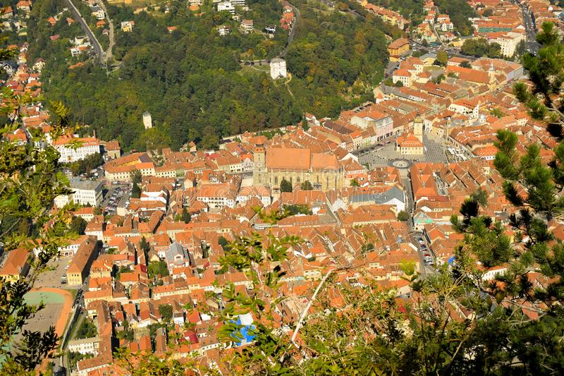 Brasov Old City. Council Square. Old City Hall. Autumn view from above Tampa Mountain. Brasov Old City. Autumn view from above Tampa Mountain. The Council royalty free stock photo