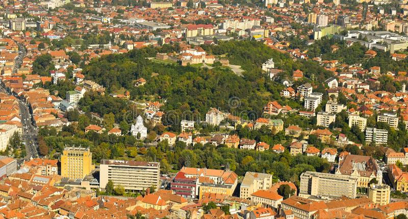 Brasov Old City and hill citadel. Autumn view from above Tampa Mountain. The citadel is surrounded by 18th-19th century houses, most of which are historical royalty free stock photo
