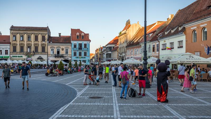 Brasov, Romania - 10 August, 2017: The Brasov Council Square (Piata Sfatului), is the main central square of the old medieval cit. Y of Brasov royalty free stock images