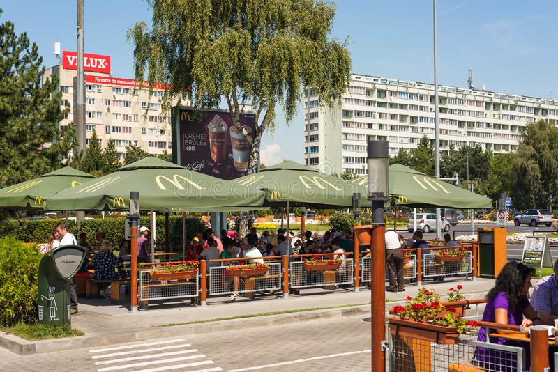 People eating lunch at McDonalds restaurant. Brasov, Romania- 08 August 2018: People eating lunch at McDonalds restaurant stock photo