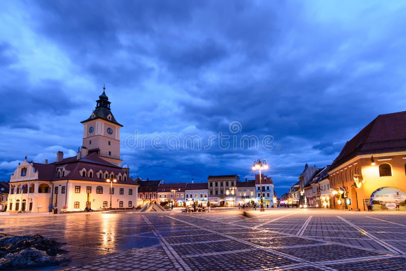 Brasov, Romania - February 23: The Council Square on February 23, 2016 in Brasov, Romania. Panoramic horizontal view with famous. Buildings, beautiful sky in royalty free stock photos