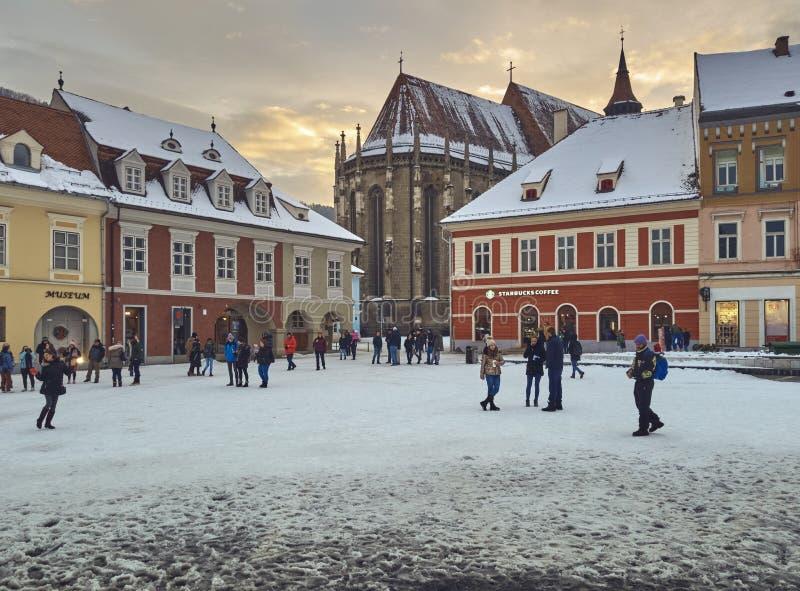 Snowy Council Square and Black Church, Brasov, Romania stock photo