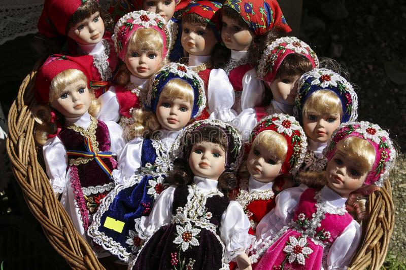 BRASOV, ROMANIA - JULY 28,2018: Traditional porcelain dolls for sale in a souvenir store in Bran village, Romania.  stock photography