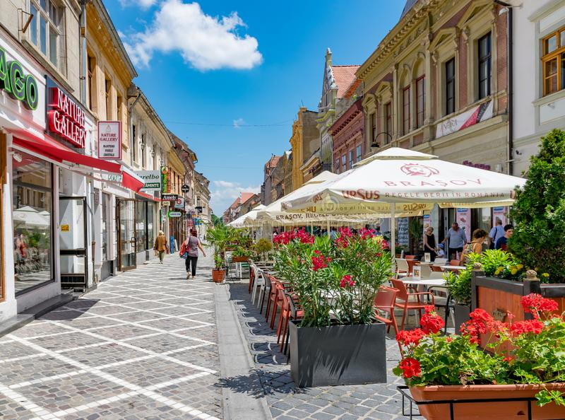 BRASOV, ROMANIA - 19 JUNE, 2018: Beautiful pedestrian street in Brasov, Romania royalty free stock image