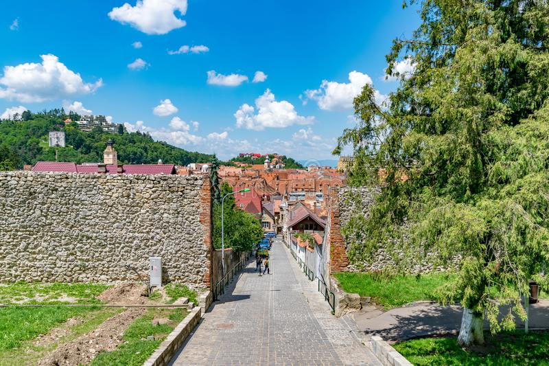 BRASOV, ROMANIA - 19 JUNE, 2018: Beautiful street in Brasov, Romania royalty free stock image