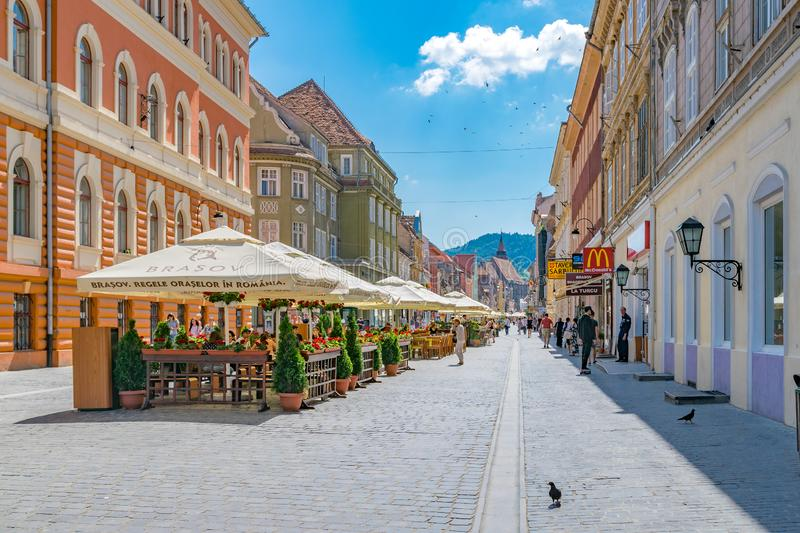 BRASOV, ROMANIA - 19 JUNE, 2018: Beautiful street in Brasov, Romania stock photography