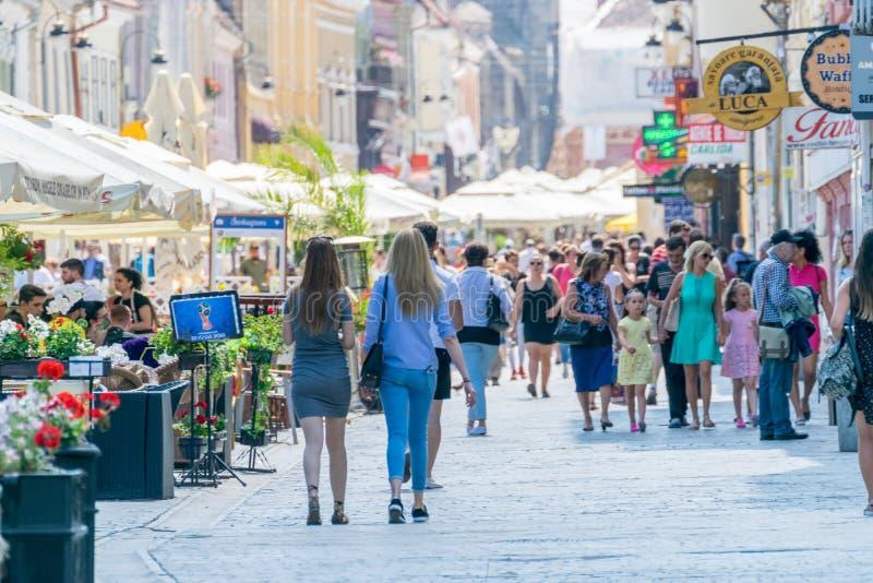 BRASOV, ROMANIA - 19 JUNE, 2018: People walking on a pedestrian street in Brasov, Romania stock images