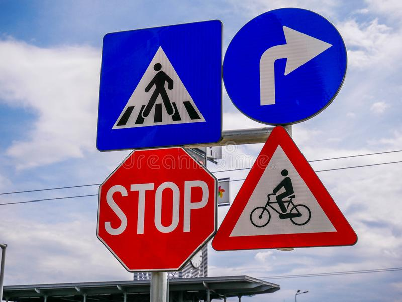 Traffic street signs in front of the local mall. Brasov, Romania- 04 May 2019: Traffic street signs in front of the local mall royalty free stock photography