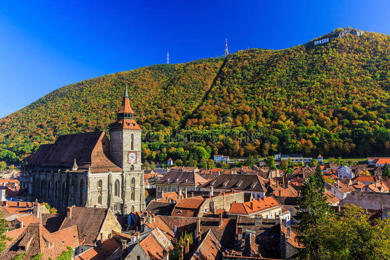 Brasov, Romania. Brasov and it's most important landmark, the Black Church towers over the old town. Transylvania, Romania stock photos