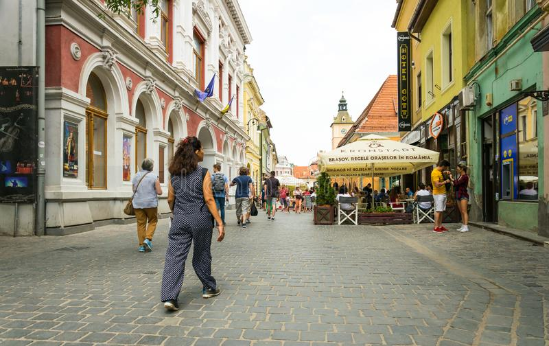 Colorful streets of the medieval European city of Brasov in Romania and modern cafe royalty free stock photos