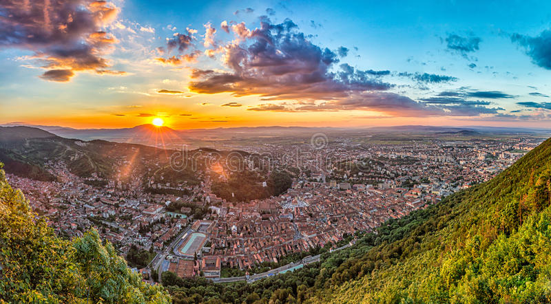 Brasov, Transylvania, Romania - Fall, 2014: A view of the city at sunset from Tampa mountain stock photography