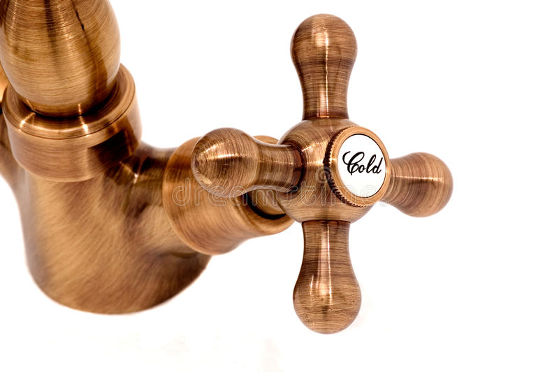 Brass Antique cold tap handle stock photography