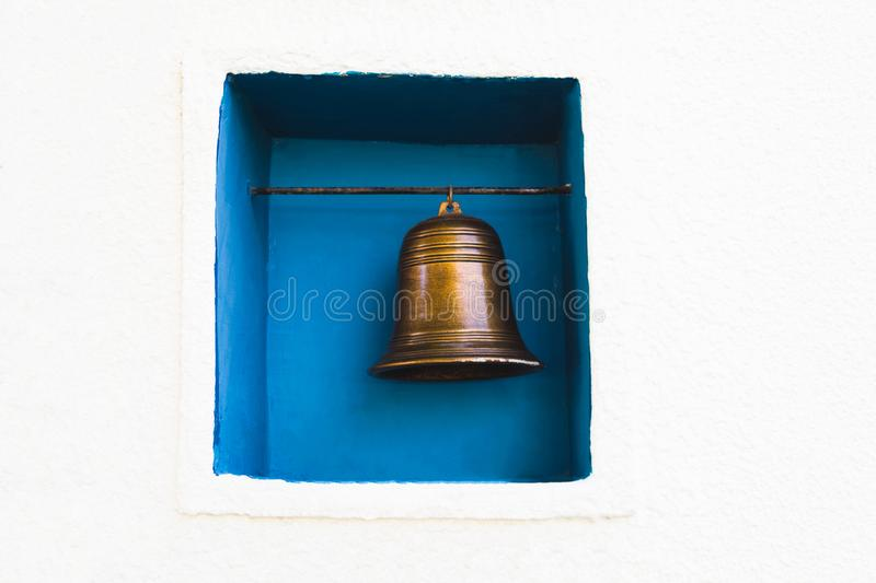 Brass bell decorate. Hanging in wall frame stock image