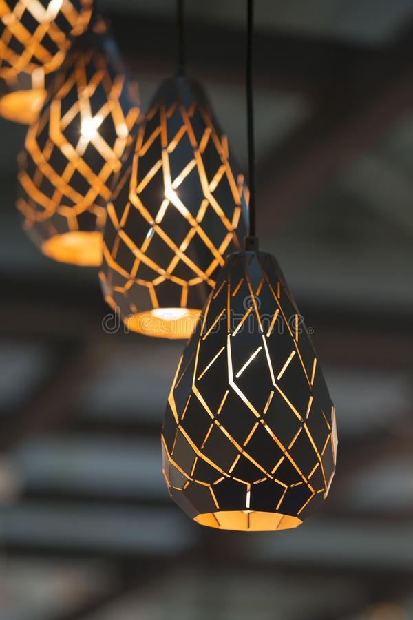 Brass With Black Metal Chandelier Oval Lamps In The Form Of Drop Copper Hanging Lamps Interesting Shape And Texture Stock Image Image Of Chandelier Bronze 141193721