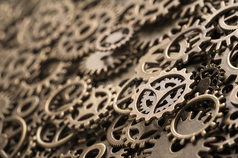 Brass cog wheels, background with copy space. Brass cog wheels, steampunk background, texture with copy space stock image