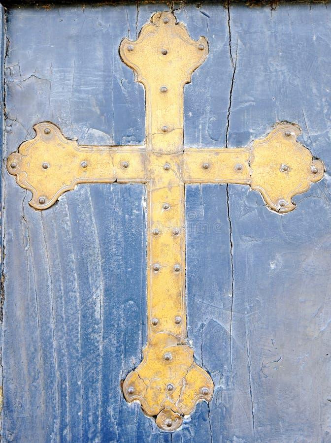 Brass crucifix on blue wooden retro background in Este, Padua, Italy. Brass crucifix on blue wooden retro background in Este, Padua royalty free stock photo
