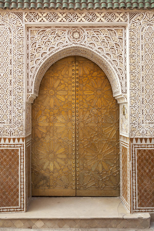 Brass decorated Moroccan door stock photography