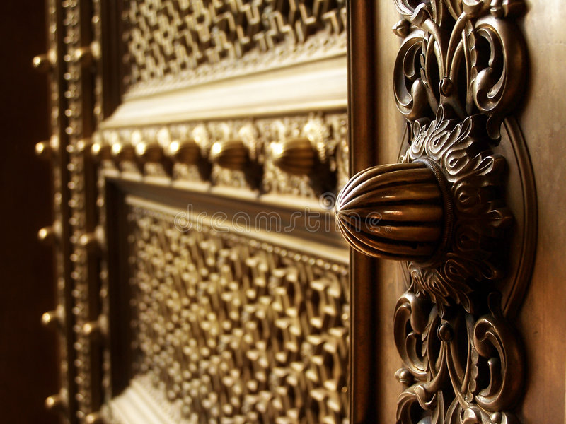 Brass door. Details from a brass door at the City Palace, Museum, Jaipur royalty free stock photo
