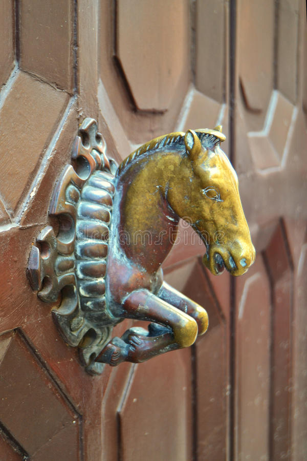 Brass Door Handle of a Horse. A brass door handle of a horse on a house in Venice stock photos